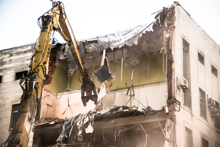 Building demolition with hydraulic crashers