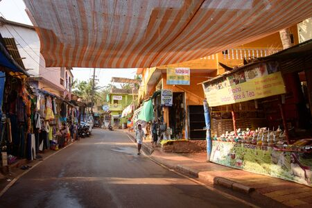 Arambol, Goa, Iindia - March 22, 2017: Street shops of sale of souvenirs and clothes for tourists