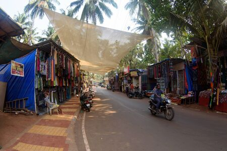 Street shops of sale of souvenirs and clothes for tourists in the Arambol village