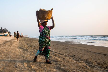 India, Goa, March 22 2017 Seller on the beach Goa Editorial