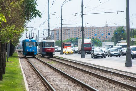 Russia, Moscow - May 15, 2018: Public tram traffic on summer city street Editorial