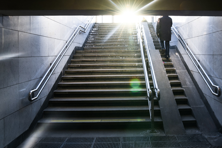 Sun rays on the stairs exit of a street underpass Banco de Imagens