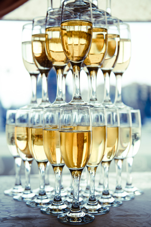 semisweet: Pyramid of glasses of champagne Stock Photo
