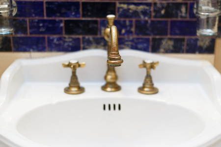 bronzy: turned off bronzy metal tap of retro design