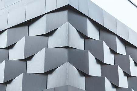 tile cladding: Angle of black metal wall of futuristic building. Abstract architectural pattern Stock Photo