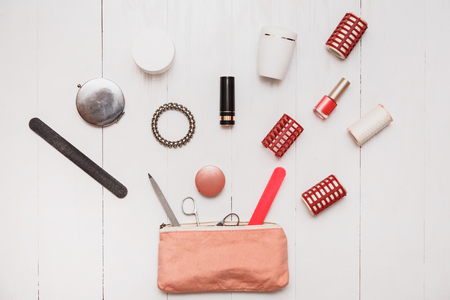 Bottomless female beautician. An infinite number of things stored in handbags. A bunch cosmetics