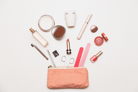 The contents of womens handbags. Make up bag with cosmetics