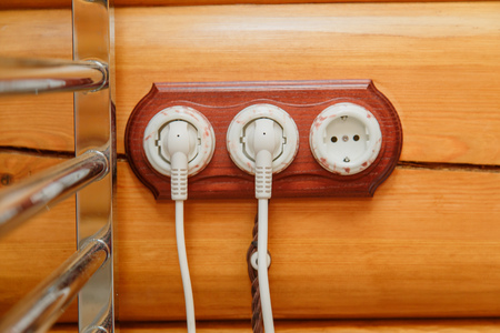 wall socket: Old fashioned electricity switches, socket, electric wire in on a wooden wall.