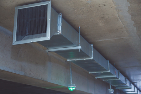Fire exhauster in a multi-level parking building