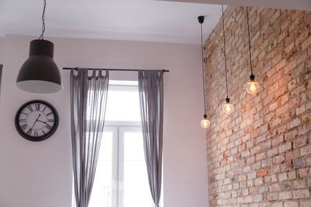 Modern interior with brick wall loft lamps