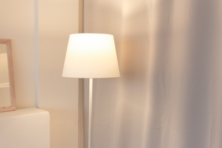 Soft colour room with floor lamp switched on