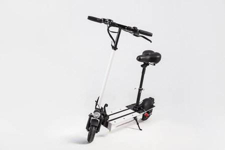 Electrick kick scooter with seat.
