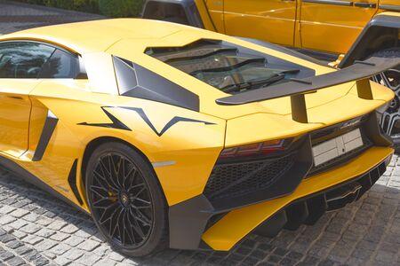 DUBAI, UAE - JANUARY 08, 2019: yellow luxury supercar Lamborghini Aventador Roadster in Dubai
