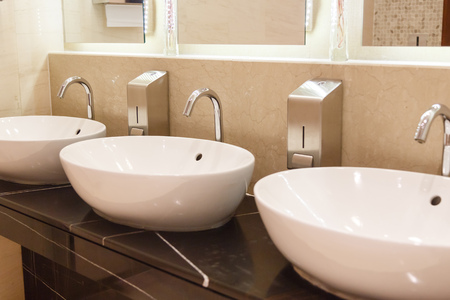 White sinks with taps Stock Photo