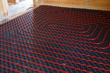 Underfloor heating pipes. Low temperature heating concept 免版税图像