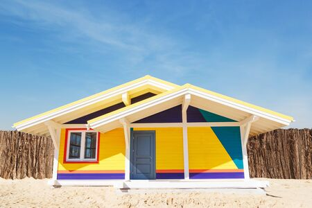multicolored wooden house on the beach used for resting.