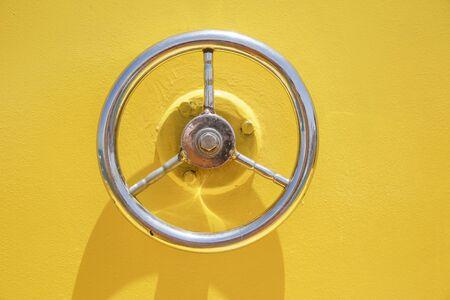 Wheel hatch on yellow vessel door