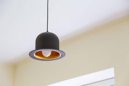 Modern black hanging lamp in shape of hat