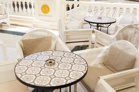 Round marble stone tables in the outdoor restaurant