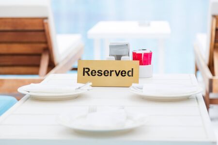 Reserved table in the lounge area by the pool Stok Fotoğraf