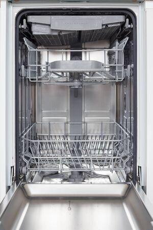 Empty new dishwasher with open door