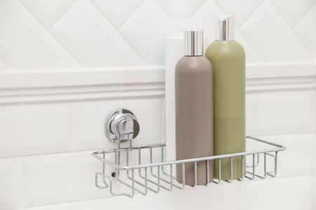 Toiletries bottles on suction cups compact bath shelf, fixing on tiled wall without drilling.