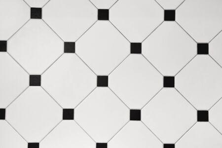Ceramic white octagon with tessellation black tiles background.