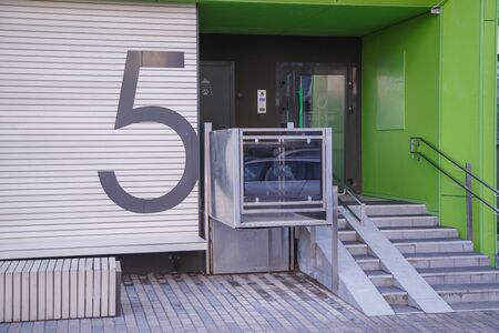 The special elevator for the disabled at the entrance to the living house