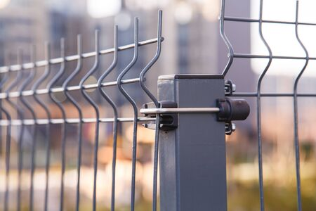 Fence made of steel welded mesh wire panels. Close-up view Stockfoto