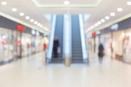 abstract blur and defocused use escalstors in luxury shopping mall or department store interior for background
