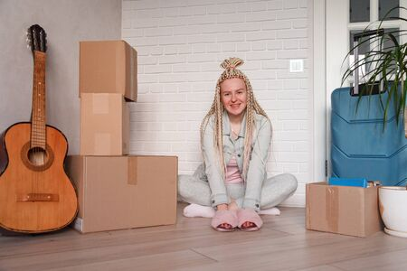 Young woman moved to a new apartment to live separately from her parents. Reklamní fotografie