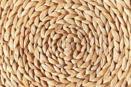 Wicker round placemat surface texture top view. Archivio Fotografico - 142968923