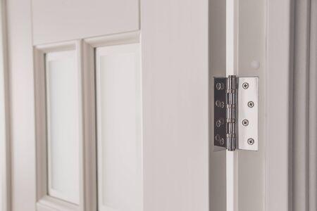 stainless door mortised hinge on a white door. Reklamní fotografie