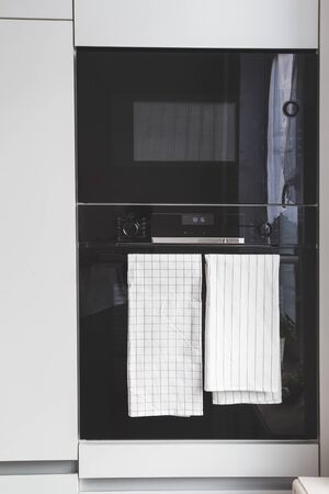 Modern built-in microwave and oven in the kitchen close-up 写真素材