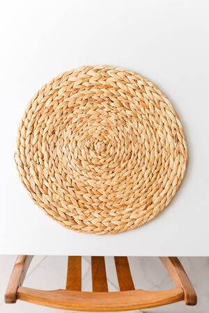 Wicker straw stand and chairin titchen. View from above. Flat lay, top view minimal social media template.