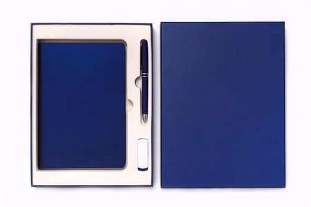 Corporate style box with pen, flash drive and notebook isolated on white background. View from above Reklamní fotografie