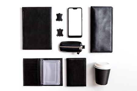 Flat lay set Men's classic clothing, jacket pants shirt bow tie leather belt shoes wrist watch wallet pens umbrella cane car keys isolated items on white background top view. Male fashion, business
