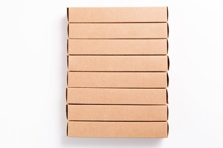 Oblong cardboard boxes on white background. Mockup image. Delivery and package concept.