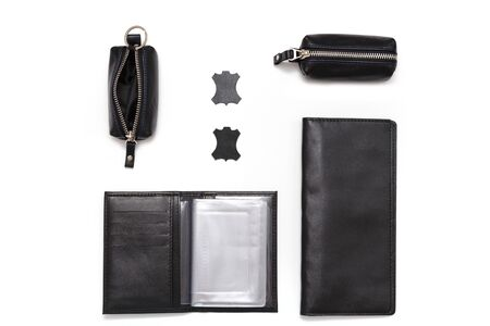 Fashionable black leather male accessories isolated on white background. Male accessories. Wallet, purse, key holder, business card holder. Top view, flat lay