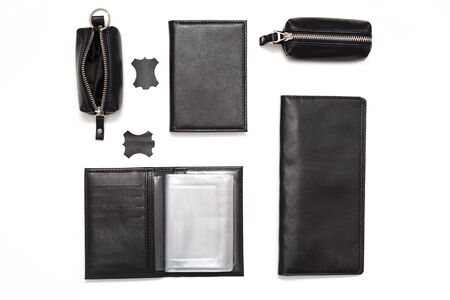 Fashionable black leather male accessories isolated on white background. Male accessories. Wallet, purse, key holder, business card holder. Top view, flat lay. Reklamní fotografie