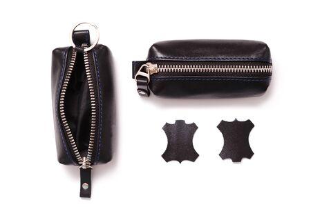 Fashionable black leather men's key holder case isolated on white background.