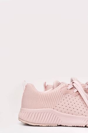 Pink female sneakers isolated on white background. Sport casual shoes