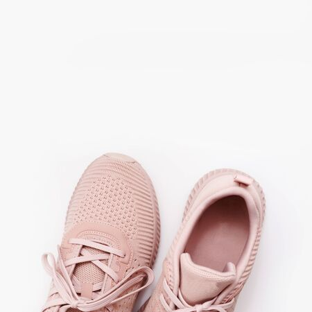 Pink female sneakers isolated on white background. Flat lay, top view. Sport casual shoes Reklamní fotografie