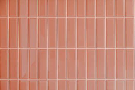Pink glossy upright rectangular ceramic tile, background, texture. Standard-Bild