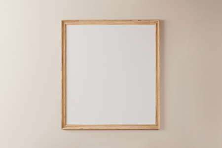 Wooden frame with white background on pastel painted wall