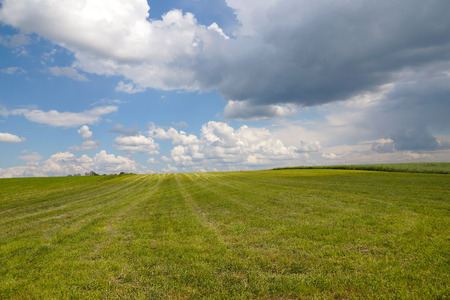 Storm clouds are moving quickly on the fields, horizontal frame Stock Photo