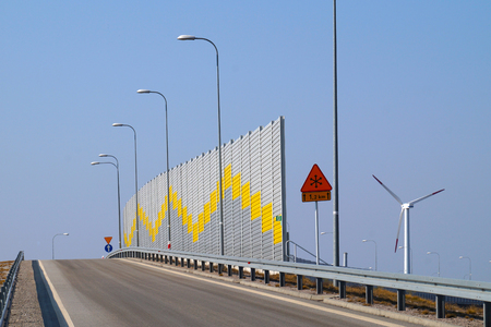 Acoustic wall that protects residents against noise generated by passing cars