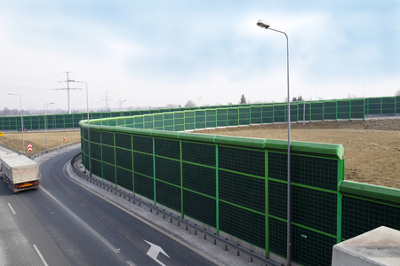 A noise barrier (also called a soundwall, noise wall, sound berm, sound barrier, or acoustical barrier) is an exterior structure designed to protection of people against noise.