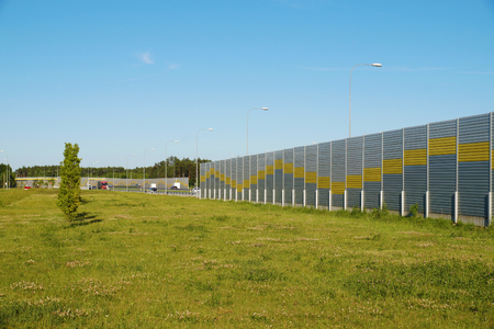 The area next to the highway is protected by sound panels Stock Photo