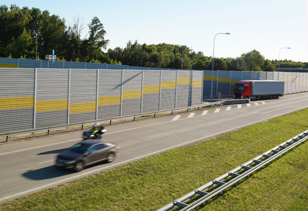 The motorway is protected against noise emission by noise-absorbing barrier (also called a soundwall, noise wall, noise barrier, sound barrier, or acoustical barrier) is an exterior structure designed to protection of people against noise.